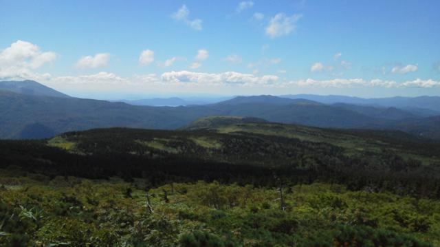 左が秋田駒ケ岳、右下は田沢湖.png